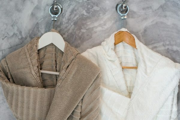 Soft, clean, fluffy bathrobes are a must. They make you feel like you've just entered a spa, in your own home! You could hang them on a fancy hanger on the back of your bathroom door. You could even name the hangers with chalk, so if you have guests you can make them feel pampered too.