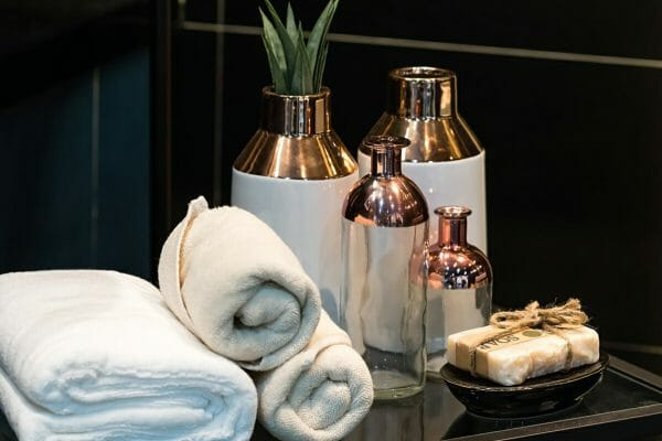 Go metallic. Metallic brass and gold features are very stylist and add some extravagance to your hotel style bathroom. If you want a to add some textures you could choose some hammered brass accessories.